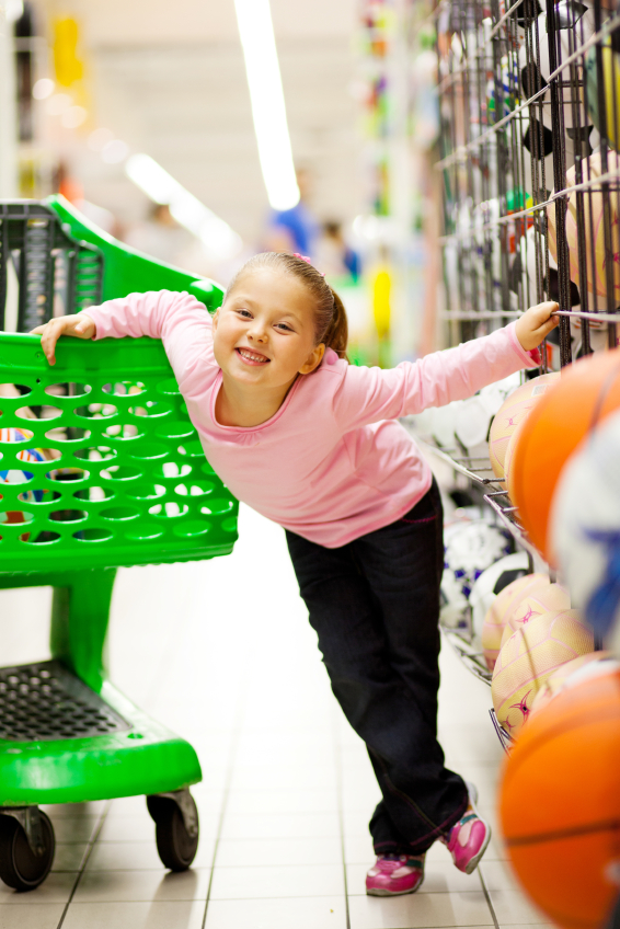 little girl in supermarket